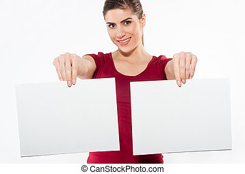 woman holding two white papers