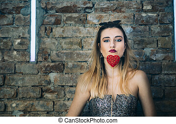 Young woman holding valentine's heart gift