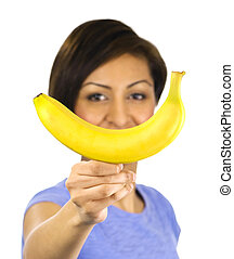 Young woman holds a banana
