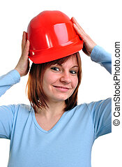 young woman holds a red safety helmet