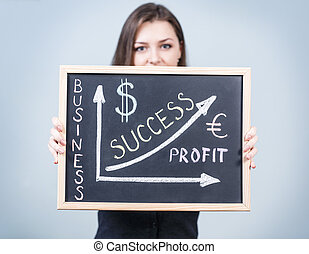 Young woman holds business graph