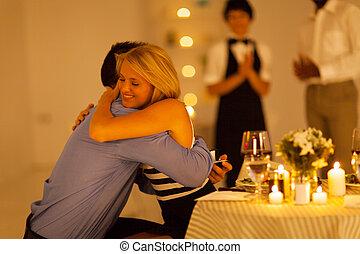 young woman hugging boyfriend - young woman hugging her...