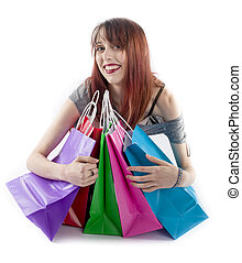 Young Woman Hugging Colorful Shopping Bags