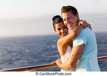 young woman hugging her boyfriend on cruise
