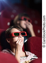 Young woman in 3D movie