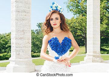 Young woman in a beautiful dress posing