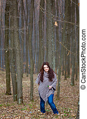 Young woman in a beech forest