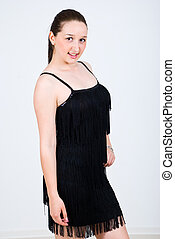 Young woman in a black short dress