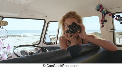 Young woman in a camper van 4k - Close up from inside of a ...