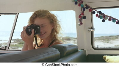 Young woman in a camper van 4k - Close up from inside ...