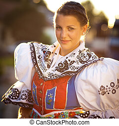 Young woman in a ceremonial dress - Keeping tradition alive:...