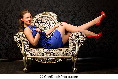Young woman in a chair
