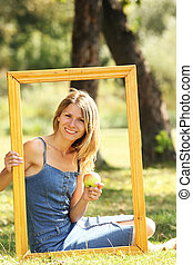 young woman in a frame