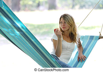 young woman in a hammock