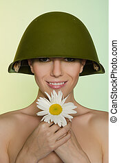 Young woman in a helmet with chamomile