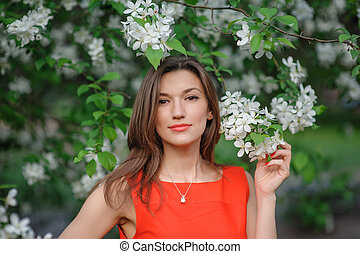 young woman in a park in spring