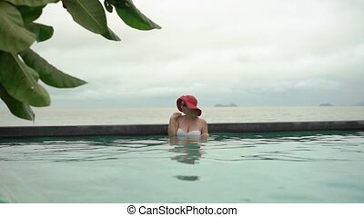 Young woman in a pool