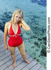 young woman in a red bathing suit