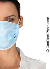 Young woman in a surgical mask