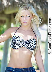 Young woman in a swimsuit ttop