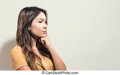 Young woman in a thoughtful pose