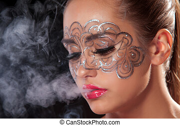 Young woman in a veil of cigarette - Female inhale smoke...