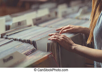 Young woman in a vinyl record store