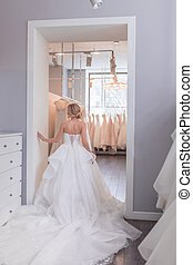 Young woman in a wedding store