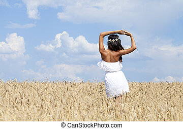 Young woman in a wheat golden field - Beautiful young woman ...