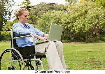 Young woman in a wheelchair with a