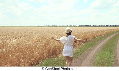 woman in a white dress runs across the road