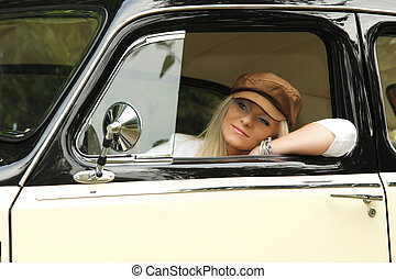 young woman in an old car