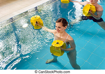 Young woman in aquarobics class