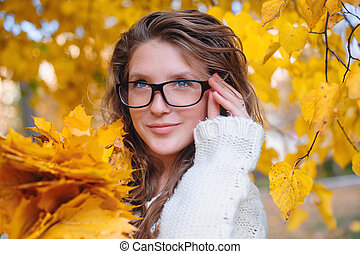 young woman in autumn with glasses