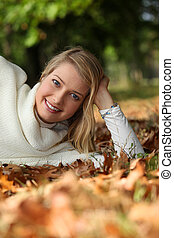 young woman in autumnal setting