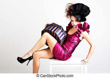 Young Woman in Avant Garde Attire - A young woman dressed in...