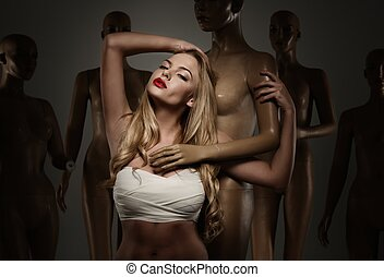 Young woman in bandage among mannequins - a plastic surgery concept
