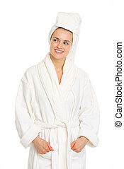 Young woman in bathrobe looking on copy space