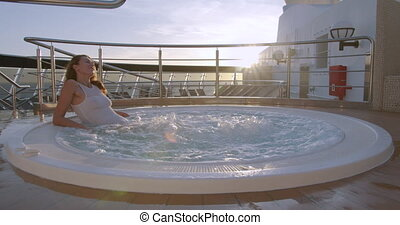 Young woman in bikini in hot tub. Concept chill out, relax, leisure time