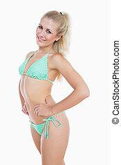 Young woman in bikini smiling