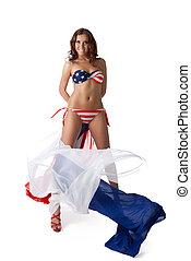 Young woman in bikini with fabric