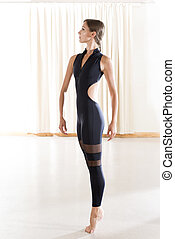 Young Woman in Black Ballet Wear in Starting Position