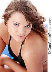 Young woman in black bikini