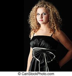 Young woman in black elegant dress