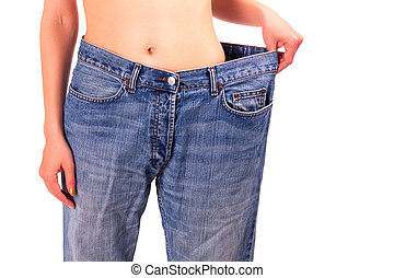 young woman in blue jeans weight loss concept, isolated on white background