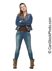 Young Woman in Blue Jeans with Arms Crossed