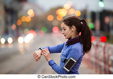 Young woman in blue sweatshirt running in the city -...