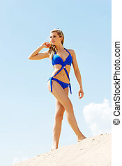 Young woman in blue swimsuit