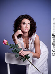 woman in bridal dress with rose