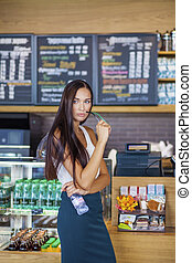 Young woman in cafe shop